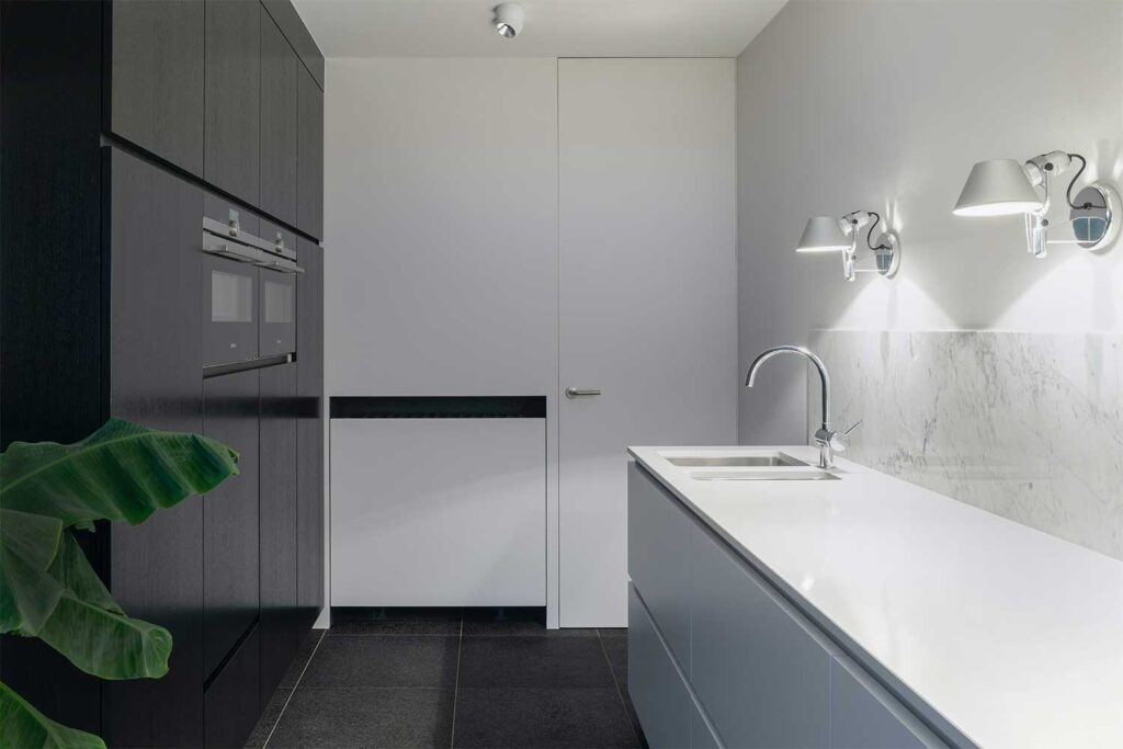 White Paint grade Door featured in Kitchen